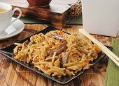 foto of lo mein  - Beef lo mein with chopsticks and green tea - JPG