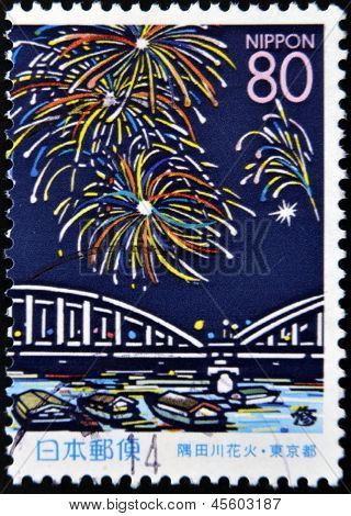 JAPAN - CIRCA 1999: A stamp printed in Japan the prefecture Hokkaido salute over the Sumida River