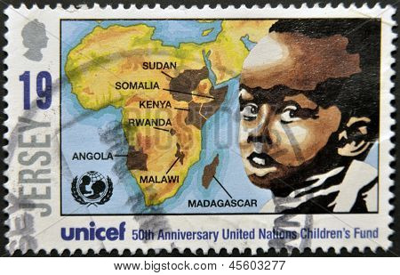 dedicated to 50th anniversary united nations children�s fund shows a boy and a map of africa