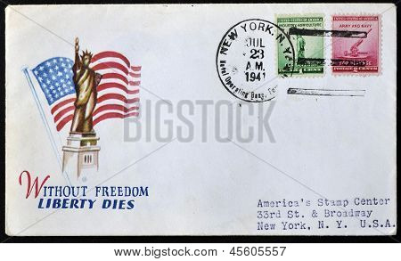 A stamp printed in USA shows the statue of liberty and 90-millimeter Anti-aircraft Gun