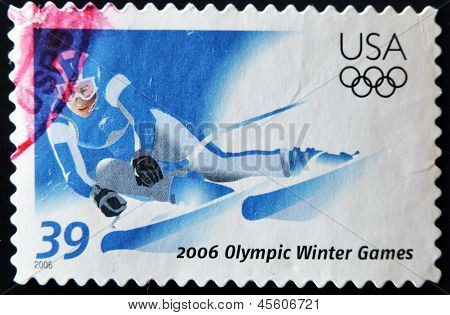 stamp printed in USA dedicated to olympics winter games shows slalom