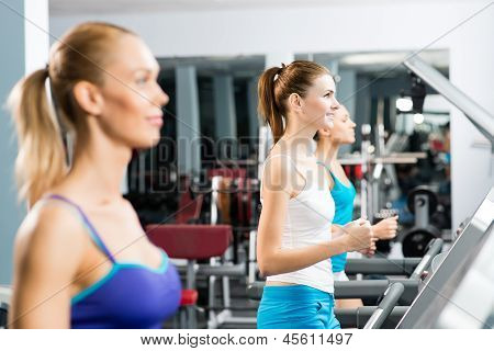women running on a treadmill