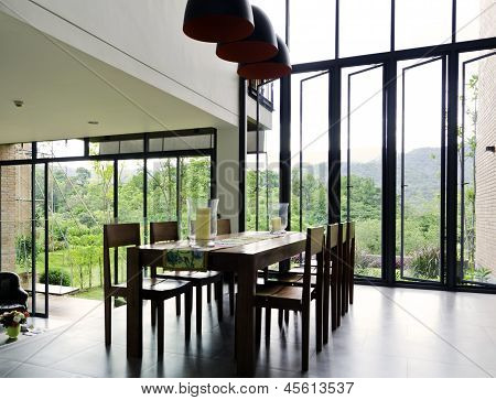 Dining Room Interior With Wooden Table And Chairs
