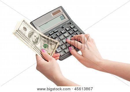 Calculator And Money In Woman's Hands