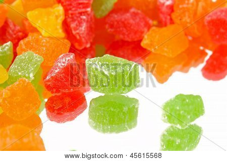 Fruit Candy Multi-colored On The Reflective Surface
