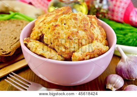 Fritters Chicken In A Pink Bowl On The Board