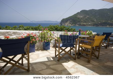 Empty Seats In Clifftop Cafe Facing The Sea, Greece