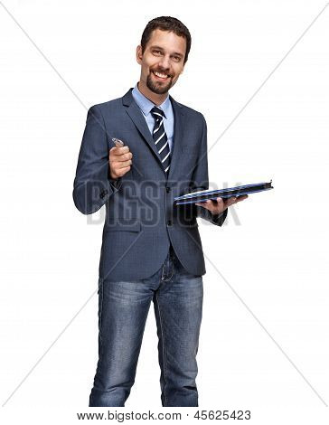 Portrait of a young business man showing at you with pen in hand