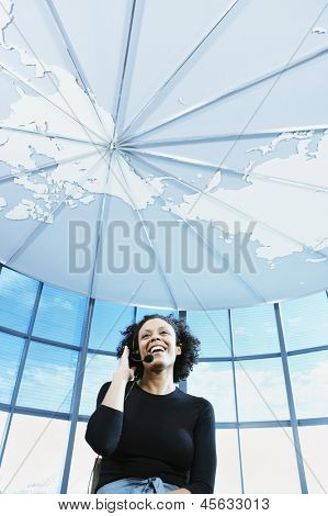 Businesswoman with earpiece laughing