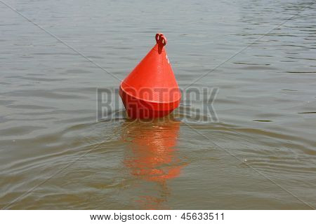 A Red Channel Marker Guides Boats Through The Water, Buoy For A Boat
