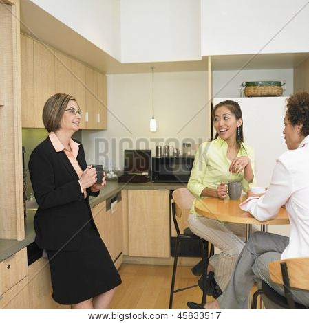 Businesswomen talking in break room