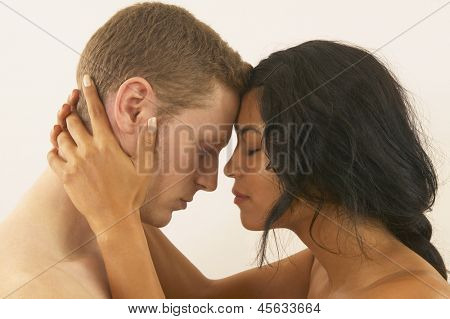 Interracial couple hugging