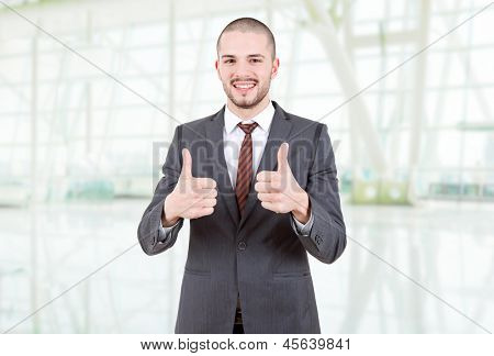 business man going thumbs up at the office