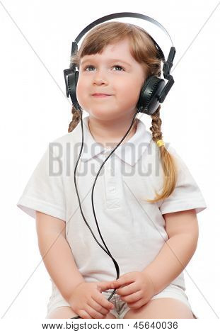 little girl listens music in ear-phones
