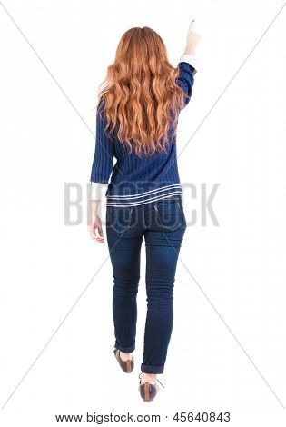 back view of walking  woman . beautiful redhead girl pointing.  backside view of person.  Rear view people collection. Isolated over white background. office worker woman going
