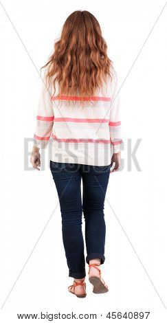 back view of walking  woman . beautiful redhead girl in motion.  backside view of person.  Rear view people collection. Isolated over white background. A girl with long, curly red hair goes somewhere