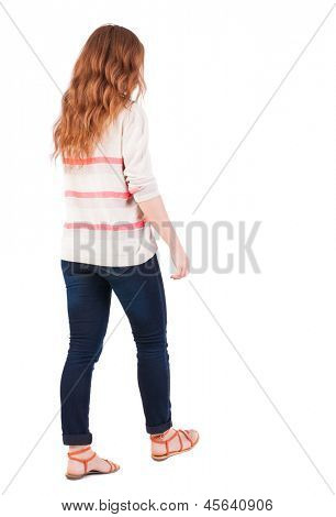 back view of walking  woman . beautiful redhead girl in motion.  backside view of person.  Rear view people collection. Isolated over white background. A girl with flying red hair walks past us