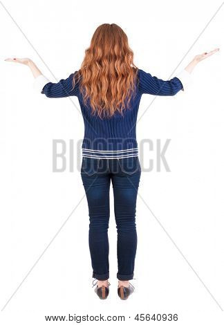 Back view Beautiful woman  looking at wall and Holds a hand up. Rear view people collection.  backside view of person.  Isolated over white background. redhead girl is holding something in both hands
