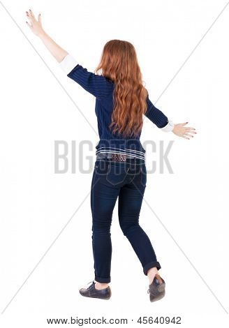 back view walking woman. beautiful redhead girl in motion.  backside view person.  Rear view people collection. Isolated over white background happy girl goes with the placed his hands open to embrace