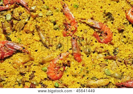 closeup of a typical paella mixta from Spain, with seafood and chicken