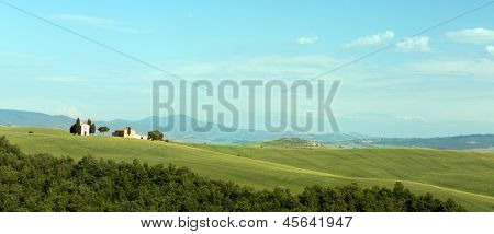 Panoramic view on the Tuscan hills near Pienza with small chapel on rolling hills