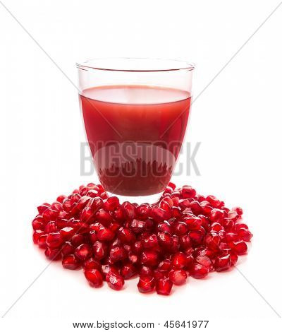 Isolated image of pomegranate juice and fresh seeds