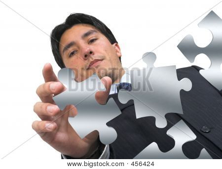Business Man Arranging Puzzle On White