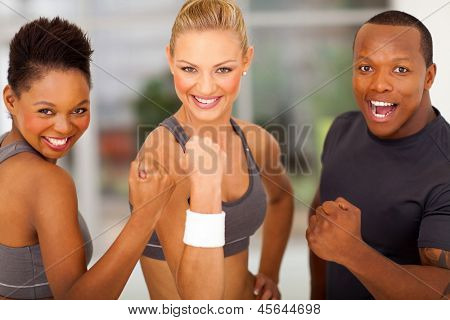 exciting group of fit people waving fist