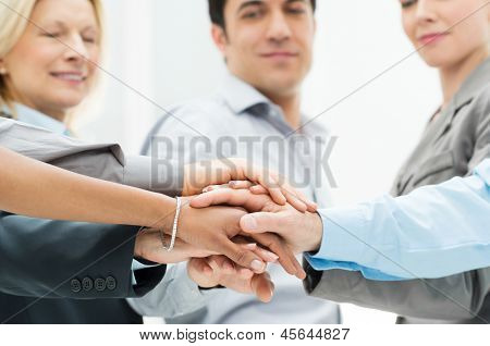 Group Of Businesspeople With Stacked Hands Showing Unity and Teamwork