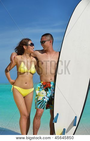 happy young asian couple have fun and romantic time at  summer on beautiful white sand beach