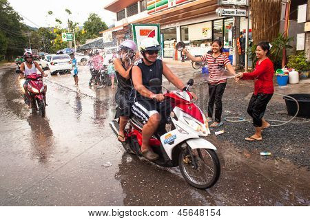 KO CHANG, THAILAND - APR 14: People celebrated Songkran Festival, on 14 Apr 2013 on Ko Chang, Thailand. Songkran is celebrated in Thailand as the traditional New Year's Day from 13 to 16 April.