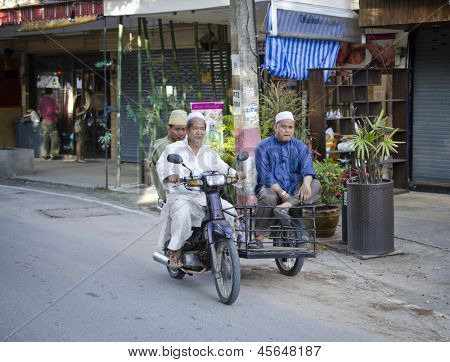 PHUKET, THAILAND - MAY 12: Members of the Muslim community in Thailand returning from prayers. On may 12, 2013 in Phuket, Thailand. Three percent of population of Thailand - Muslims.