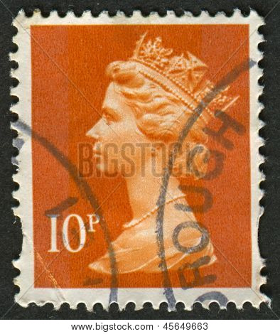 UK-CIRCA 1993: A stamp printed in UK shows image of Elizabeth II is the constitutional monarch of 16 sovereign states known as the Commonwealth realms, in dull orange, circa 1993.