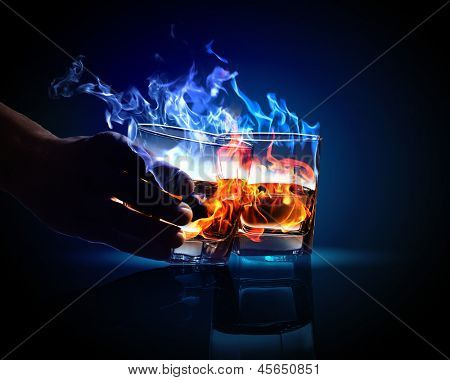 Image of two glasses of burning absinthe