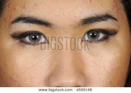 Closeup Of  Young Asian Woman With Contact Lenses
