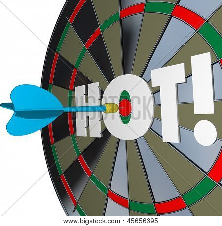 A dart hits the center of a bulls-eye with the word Hot to illustrate a great job or perfomance and top popularity level or buzz