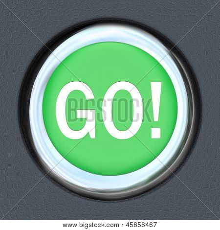 The word Go on a car start button to illustrate acceleration and movement forward toward a goal or to speed up for a race or progress down a road or path to success
