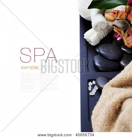 spa concept (zen stones, Herbal massage balls and towel) over white (with easy removable sample text)