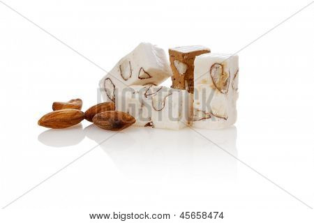 Belgian nougat blocks and almonds isolated on white