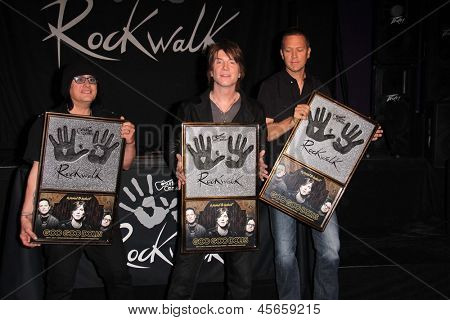 LOS ANGELES - MAY 7:  Robby Takac, John Rzeznik, Mike Malinin at the Goo Goo Dolls RockWalk Induction at the Paley Center For Media on May 7, 2013 in Beverly Hills, CA