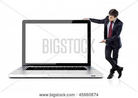 attractive young business man with laptop on white background