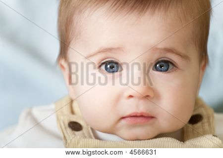 Portrait Of Pensive Blue-eyes Baby
