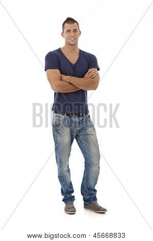 Full length portrait of young muscular man looking at camera, smiling, isolated on white.