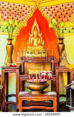 BANGKOK, THAILAND - AUGUST 18 2008: buddha altar in a budhist temple in bangkok thailand on august 18th 2008
