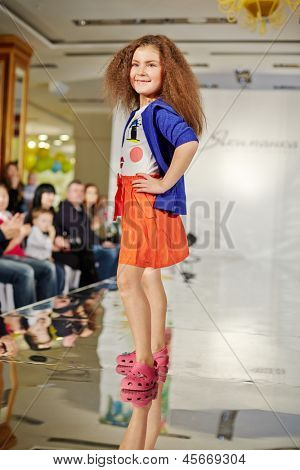 MOSCOW - MAR 17: Girl model performs at podium of Children Gallery Yakimanka during 5th Yakimanka Kids Fashion Week, Mar 17 2012, Moscow Russia. Within Fashion Week shown lines of children best brands
