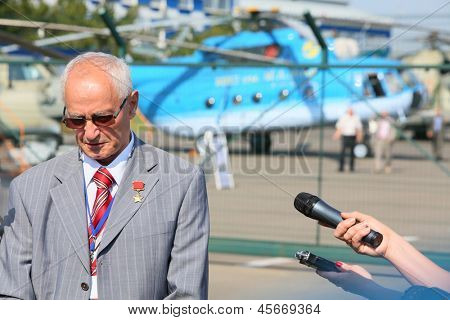 MOSCOW - AUG 2: Gurgen Karapetyan gives interviews on holiday devoted to 50th anniversary to Mi-8 near Helicopter Plant named Mil, Aug 2, 2012 Moscow, Russia. G.Karapetyan - honored pilot test of USSR
