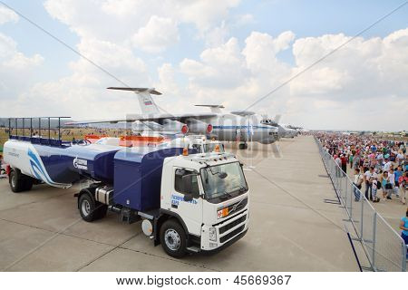 ZHUKOVSKY - AUGUST 12: Machine for refueling, aircraft, and crowd of spectators on airshow devoted to 100 anniversary of Russian Air Forces on August 12, 2012 in Zhukovsky, Moscow region, Russia.