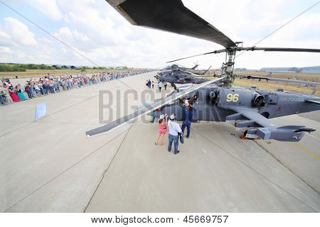 ZHUKOVSKY - AUGUST 12: Military helicopters and spectators on airshow devoted to 100 anniversary of Russian Air Forces on August 12, 2012 in Zhukovsky, Moscow region, Russia.