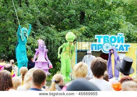 MOSCOW - AUGUST 10: Artists in colorful suits on stage at festival of street theater and carnival culture Once in park it garden named Bauman, on August 10, 2012 in Moscow, Russia.