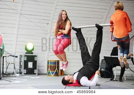 MOSCOW - AUGUST 10: Artist holds two girls by vulture rod on stage at festival of street theater and carnival culture Once in park it garden named Bauman, on August 10, 2012 in Moscow, Russia.